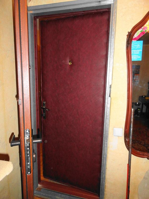 Обивка железных дверей